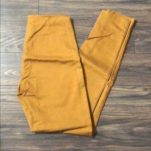 H&M mustard skinny trousers